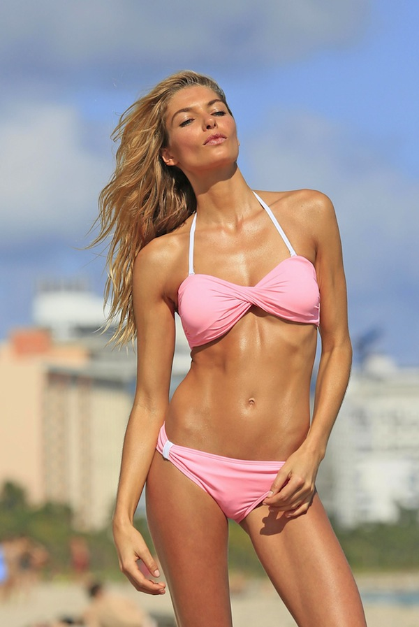 Jessica Hart shows off her fit figure for a beach photo shoot in Miami